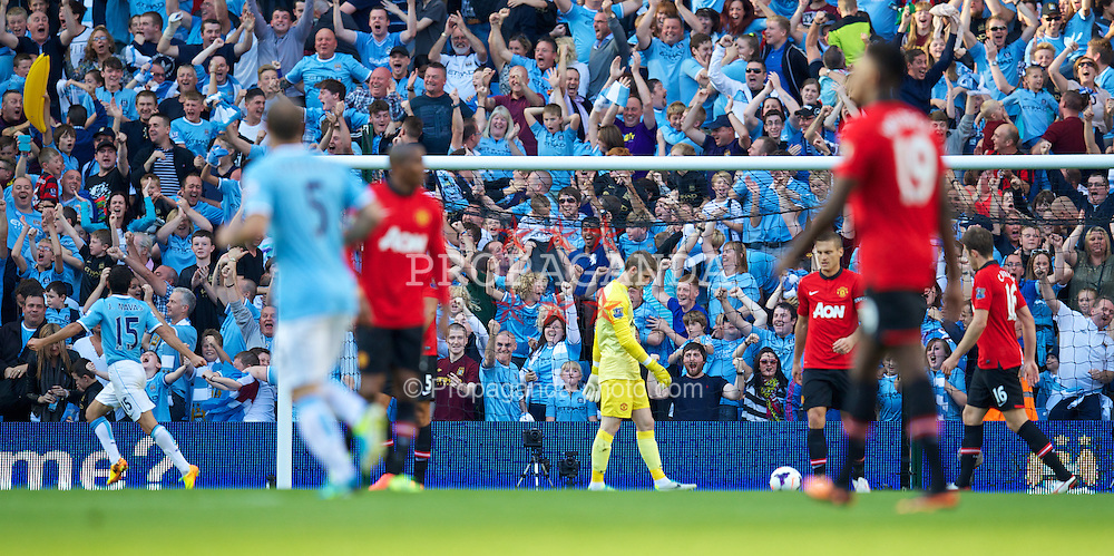 MANCHESTER, ENGLAND - Sunday, September 22, 2013: Manchester United's goalkeeper David de Gea looks dejected as Manchester City score the fourth goal during the Premiership match at the City of Manchester Stadium. (Pic by David Rawcliffe/Propaganda)