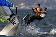 Peter Burling and Blair Tuke from New Zealand react after winning the Gold medal in the 49er Men's class medal race of the Rio 2016 Olympic Games Sailing events in Rio de Janeiro, Brazil, 18 August 2016.