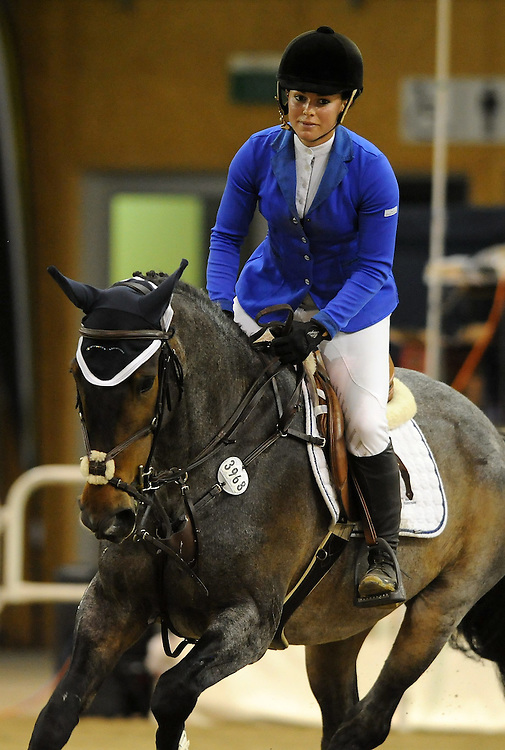 Danielle Maurer rides Blue Rinse in round 3 of the FEI World Cup Qualifier, Manfield Park, Feilding, New Zealand, Saturday, December 03, 2011. Credit: SNPA / Kerry Marshall