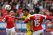 AFC Wimbledon defender Paul Robinson (6)AFC Wimbledon striker Lyle Taylor (33) tussles with Charlton Athletic defender Ezri Konsa Ngoyo (15) during the EFL Sky Bet League 1 match between Charlton Athletic and AFC Wimbledon at The Valley, London, England on 17 September 2016. Photo by Stuart Butcher.