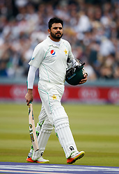 Pakistan's Azhar Ali walks off after getting out for 50 during day two of the First NatWest Test Series match at Lord's, London.