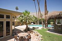 Back yard with swimming pool alongside modern home