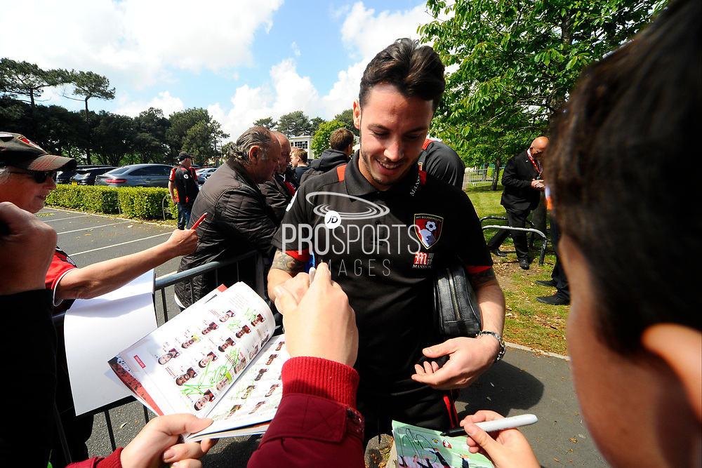 AFC Bournemouth defender Adam Smith signing his autograph as he arrives for the Premier League match between Bournemouth and Burnley at the Vitality Stadium, Bournemouth, England on 13 May 2017. Photo by Graham Hunt.