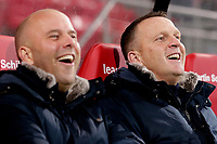 (L-R) assistant trainer *Arne Slot* of AZ Alkmaar, coach *John van den Brom* of AZ Alkmaar