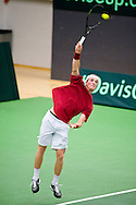 18.09.2015. Odense, Denmark. <br /> Mikael  Torpegaard of Denmark serves against Rafael Nadal of Spain during their Davis Cup match.<br /> Photo: © Ricardo Ramirez.