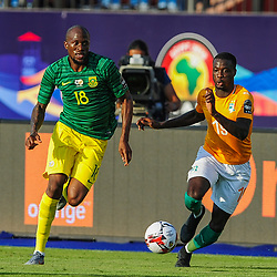 Sifiso Hlanti of South Africa takes on Nicolas Pepe of Ivory Coast during the 2019 Africa Cup of Nations Finals game between Ivory Coast and South Africa at Al Salam Stadium in Cairo, Egypt on 24 June 2019  <br /> Photo : Icon Sport