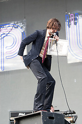 Jarvis Cocker of Pulp on the Main Stage mocks the closure of The News of the World newspaper by wiping his arse with a copy..T in the Park on Sunday 10th July 2011. T in the Park 2011 music festival takes place from 7-10th July 2011 in Balado, Fife, Scotland..©Pic : Michael Schofield.