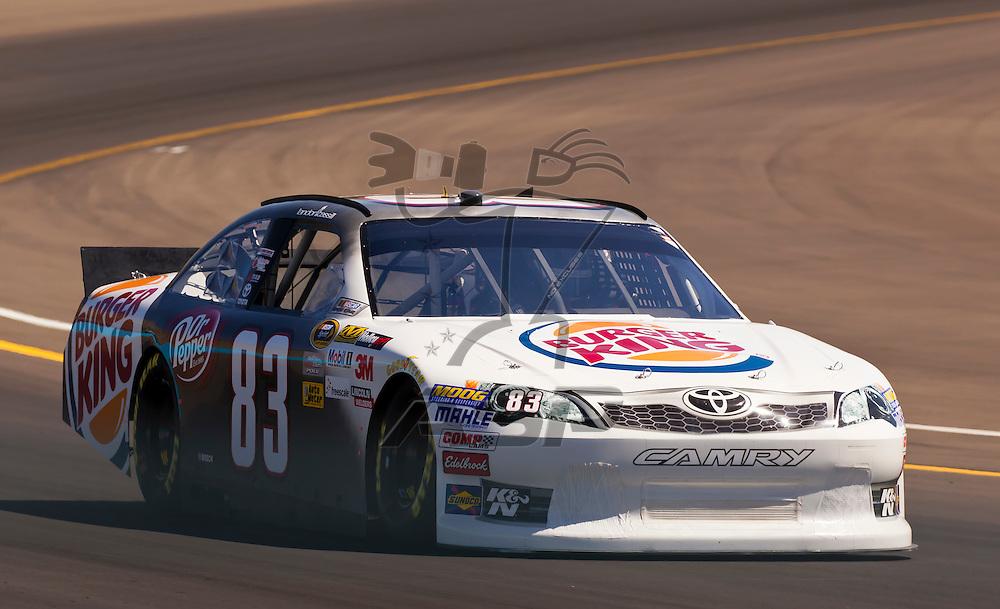 AVONDALE, AZ - MAR 03, 2012:  Landon Cassill (83) brings his NASCAR Sprint Cup car through turn 4 during qualifying for the Subway Fresh Fit 500 race at the Phoenix International Raceway in Avondale, AZ.