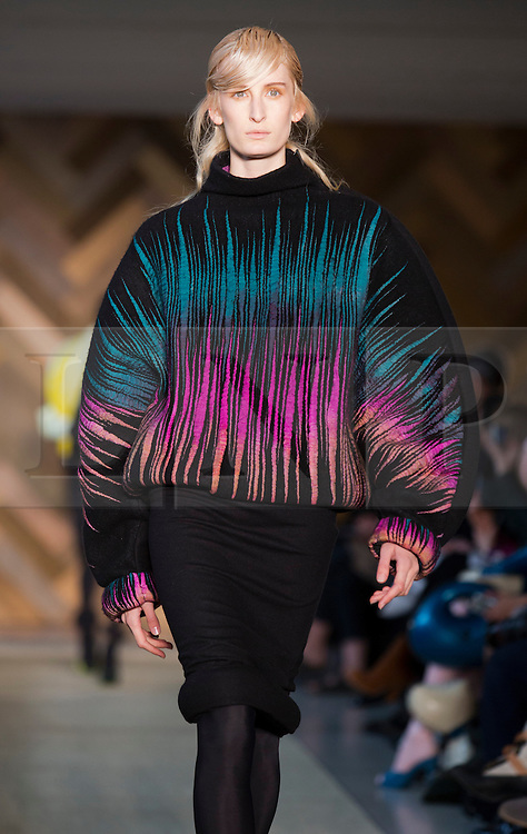 © Licensed to London News Pictures. 29/05/2014. London, England. Collection by Nam Jung Choi. 30 students of the Royal College of Art's prestigious MA Fashion programme presented their final collections in  a runway show at the RCA building in Kensington. Photo credit: Bettina Strenske/LNP