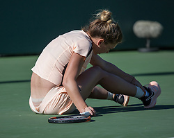 March 22, 2018 - Miami, Florida, United States - Simona Halep, from Romania, falls to the ground and checks her ankle during her match against Ocean Dodin, from France in their second round match during the Miami Open Presented by Itau at Crandon Park Tennis Center on March 22, 2018 in Key Biscayne, Florida. Halep defeated Dodin 3-6, 6-3, 7-5 (Credit Image: © Manuel Mazzanti/NurPhoto via ZUMA Press)