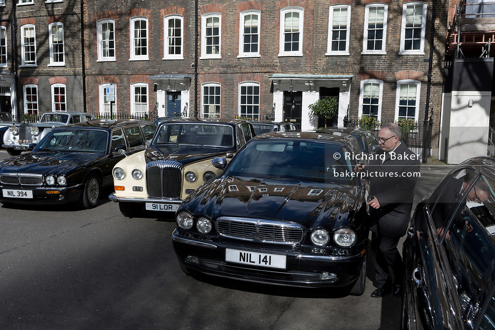 Assorted limousines are parked in Smith Square, a small square behind the Houses of Parliament, before collecting their VIP passengers - barristers who are being sworn in as QCs (aka Silks in legal vernacular), on 11th March 2019, in London, England.