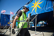 Co-owner Nelson Quiroga ratchets down a support strap while Circus Vargas pitches the big tent in preparation for a weekend of performances at the Great Mall of the Bay Area in Milpitas, California, on August 27, 2013. (Stan Olszewski/SOSKIphoto)