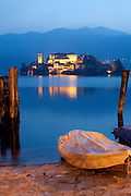 A rowboat and Isola San Giulio at dusk, Lake Orta, Piedmont.