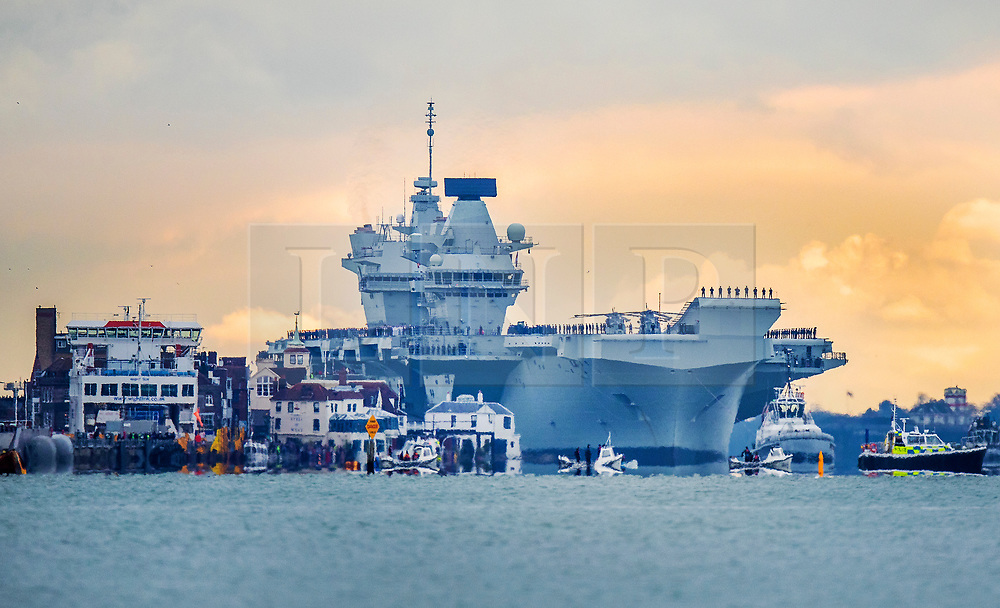 © Licensed to London News Pictures. 16/11/2019. Portsmouth, UK. HMS Prince of Wales, sister aircraft carrier of HMS Queen Elizabeth, sails past Old Portsmouth (L)  as it comes into port for the first time. The Royal Navy's  latest aircraft carrier sailed from Rosyth dockyard to begin sea trials in September. The ship, which is 280 metres long and weighs 65,000 tonnes, is expected to commission into the Royal Navy in 2020. Photo credit: Peter Macdiarmid/LNP