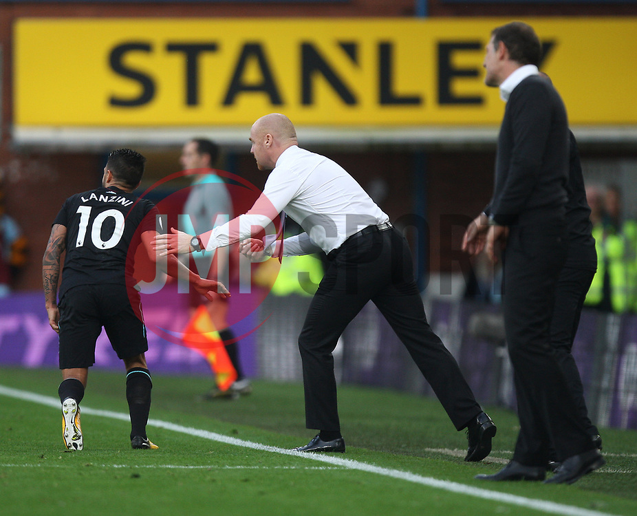 Manuel Lanzini of West Ham United (L) shakes hands with Burnley manager Sean Dyche after the two collided - Mandatory by-line: Jack Phillips/JMP - 14/10/2017 - FOOTBALL - Turf Moor - Burnley, England - Burnley v West Ham United - English Premier League