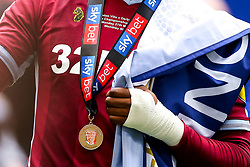 Jonathan Kodjia of Aston Villa wears his medal as he celebrates winning promotion from the Sky Bet Championship to the Premier League after winning the Sky Bet Playoff Final - Mandatory by-line: Robbie Stephenson/JMP - 27/05/2019 - FOOTBALL - Wembley Stadium - London, England - Aston Villa v Derby County - Sky Bet Championship Play-off Final