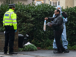 © Licensed to London News Pictures. 11/10/2018. London, UK.  A police officer holds up evidence in a bag at the scene in Hayes where a man is believed to have been shot. It is being reported that police were called at 14:43 after a passenger in a silver Mercedes, was shot. The victim died at the scene.  Photo credit: Ben Cawthra/LNP