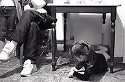 Little girl drawing under a table, Newport, South Wales, 2000's