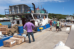 Supply boat from mainland Honduras, Utila. Everything arives in Utila by boat, from lumber to furniture, bikes to bananas.