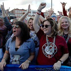 January 8, 2012; New Orleans, LA, USA;  Alabama Crimson Tide fans Rachel Goggins and Branna Burns cheer during the Fan Fest pep rally in the French Quarter for the 2012 BCS National Championship game to be played on January 9, 2012 between the Alabama Crimson Tide and the LSU Tigers at the Mercedes-Benz Superdome.  Mandatory Credit: Derick E. Hingle-US PRESSWIRE