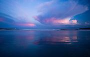Thunderhead clouds at sunset over Easton's Beach (First Beach).
