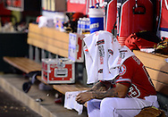 Hector Santiago covers his head with a towel in the dugout during the Angels game against the Athletics Tuesday April 21 at Angel Stadium.<br /> <br /> ///ADDITIONAL INFO:   <br /> <br /> angels.0422.kjs  ---  Photo by KEVIN SULLIVAN / Orange County Register  --  4/21/15<br /> <br /> The Los Angeles Angels of Anaheim take on the Oakland Athletics at Angel Stadium Tuesday night. <br /> <br /> 4/21/15