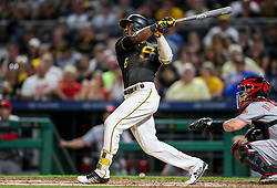 Jun 15, 2018; Pittsburgh, PA, USA; Pittsburgh Pirates center fielder Starling Marte (6) hits a RBI-sacrifice fly to right field during the sixth inning against the Cincinnati Reds at PNC Park. Mandatory Credit: Ben Queen-USA TODAY Sports