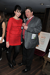 GIZZI ERSKINE and ROWLEY LEIGH at a party to celebrate the publication of A History of Food in 100 Recipes by William Sitwell held at Archer street, 3-4 Archer Street, London W1 on 11th April 2012.