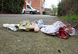 © Licensed to London News Pictures. 27/03/2019. Eltham,UK. Bloody crime scene, A teenager is in a life threatening condition after being stabbed in Eltham, London yesterday afternoon. A police cordon has been removed from the scene but left behind in an alleyway is a blood soaked t-shirt,oxygen mask and surgical gloves also covered in blood.<br /> Photo credit: Grant Falvey/LNP