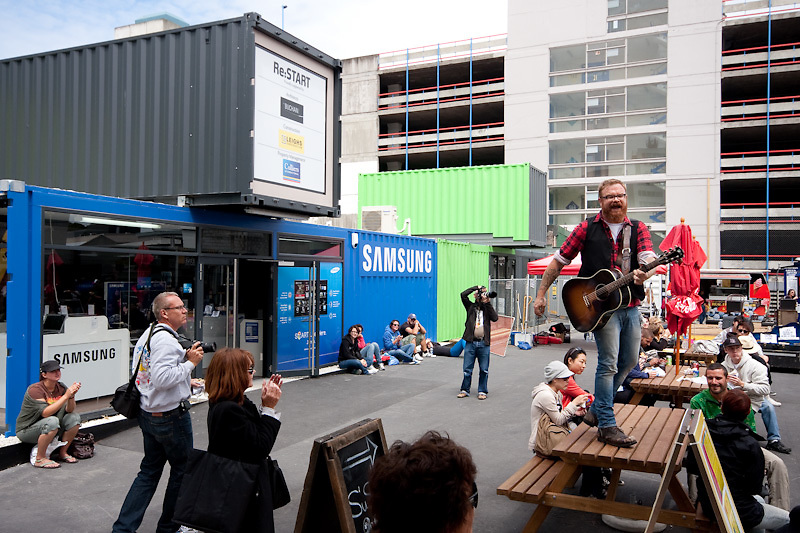 Re:START project involves using shipping containers to create a temporary retail center on the site of the shopping mall destroyed in the Christchurch earthquake in 2011. The containers have been turned into cafes and shops selling every thing from shoes to computers. Photo Joe Harrison