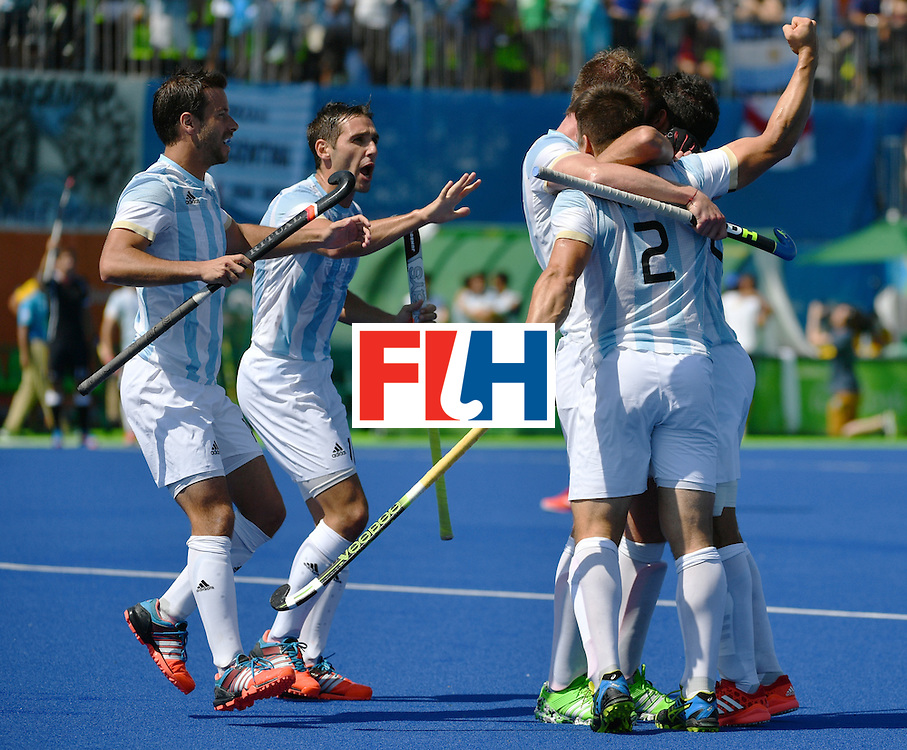 Argentina's Gonzalo Peillat (R) celebrates a goal with teammates during the men's semifinal field hockey Argentina vs Germany match of the Rio 2016 Olympics Games at the Olympic Hockey Centre in Rio de Janeiro on August 16, 2016. / AFP / Pascal GUYOT        (Photo credit should read PASCAL GUYOT/AFP/Getty Images)