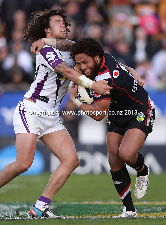 Manu Vatuvei pushes aside Kevin Proctor. NRL Rugby League match, Vodafone Warriors v Melbourne Storm at Mt Smart Stadium in Auckland on Sunday 28 July 2013. Photo: Andrew Cornaga/Photosport.co.nz