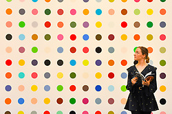"© Licensed to London News Pictures. 23/06/2017. London, UK. A staff member views ""1-Heptene"", 2004-2011, by Damien Hirst (estimate GBP0.5-0.7m) at the preview of Sotheby's Contemporary Art Sale in New Bond Street.  The auction, which is dominated by Pop art, takes place on 28 June. Photo credit : Stephen Chung/LNP"