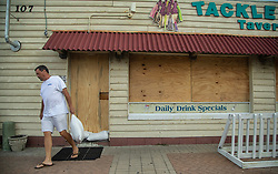 Morehead City Mayor Pro Tempore Richard Porter places sandbags around the Tackle Box Tavern in Atlantic Beach, NC, USA The bar, which boasts that it stays open 365 days per year, closed its doors on Wednesday, Aug. 12, 2018, in anticipation of Hurricane Florence. Photo by Travis Long/Raleigh News & Observer/TNS/ABACAPRESS.COM