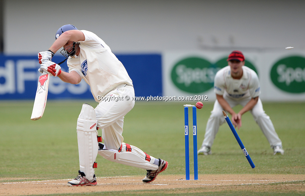 Kyle Mills is bowled by Ryan McCone. Plunket Shield Cricket, Auckland Aces v Canterbury Wizards at Eden Park Outer Oval. Auckland on Tuesday 18 December 2012. Photo: Andrew Cornaga/Photosport.co.nz