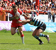 Ben Cockayne (left) of Hull Kingston Rovers is tackled by Josh Drinkwater of London Broncos during the First Utility Super League match at the KC Lightstream Stadium, Kingston upon Hull<br /> Picture by Richard Gould/Focus Images Ltd +44 7855 403186<br /> 25/05/2014