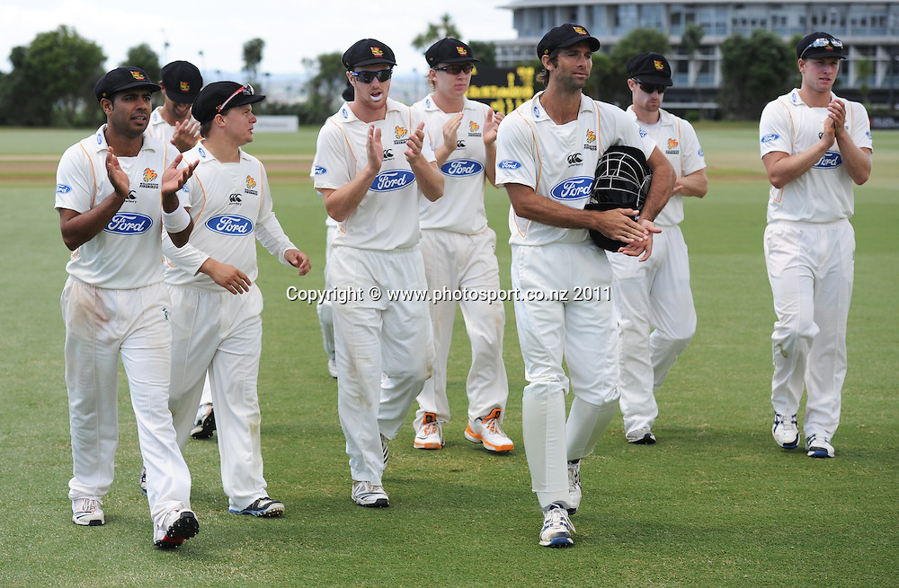 Wellington's Mark Gillespie is clapped off the field by team mates after a man of the match performance during the Ford Trophy Cricket match between Auckland and Wellinton at Colin Maiden Oval in Auckland, New Zealand on Monday 27 February 2012. Photo: Andrew Cornaga/Photosport.co.nz