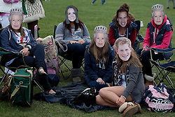 LOCATION, UK  29/04/2011. The Royal Wedding of HRH Prince William to Kate Middleton. Royal fans in Hyde Park wearing royal masks wait for the wedding to begin. Photo credit should read Matt Cetti-Roberts/LNP.