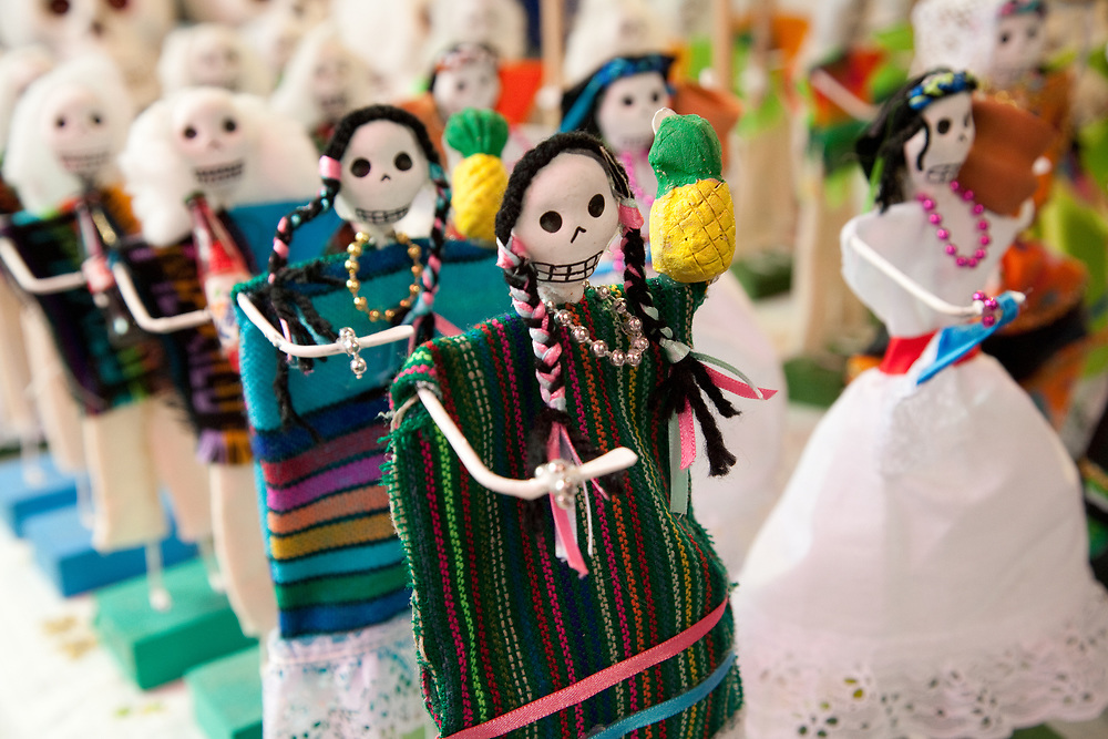 North America, Mexico, Oaxaca Province, Oaxaca, skeleton dolls for sale at market during annual Day of the Dead (Dias de los Muertos) celebration in November