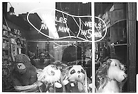 Snoopy soft toy behind shop window, Street photography. 1980