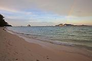 Thailand, Ko Kradan. The beach at sunset, with a rainbow.