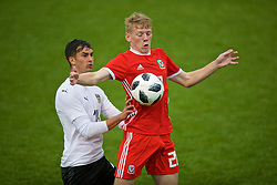 NEWPORT, WALES - Monday, October 14, 2019: Wales' Joshua Thomas (R) and Austria's Sebastian Aigner during an Under-19's International Friendly match between Wales and Austria at Dragon Park. (Pic by David Rawcliffe/Propaganda)
