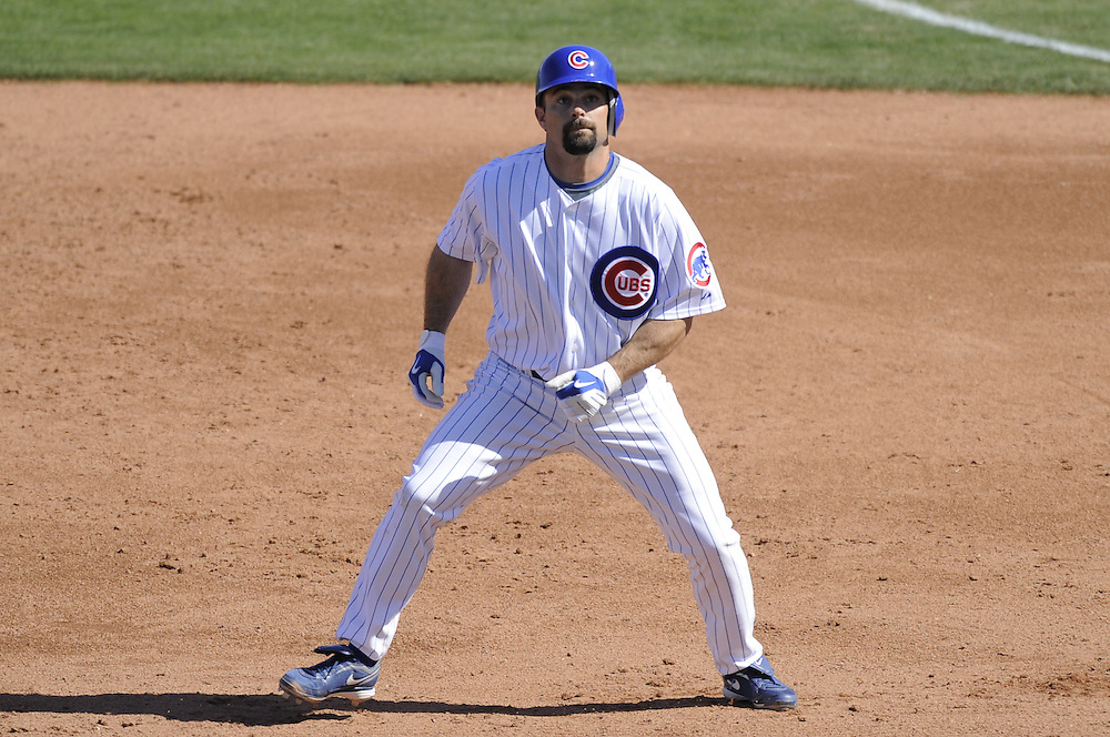 MESA, AZ - FEBRUARY 28:  Aaron Miles #7 of the Chicago Cubs runs the bases during the game against the Chicago White Sox on February 28, 2009 at HoHoKam Park in Mesa, Arizona. (Photo by Ron Vesely)