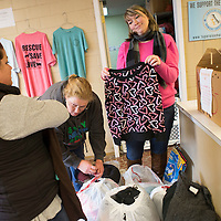 Lauren Wood | Buy at photos.djournal.com<br /> Summer Knight, right, shows Meredith Tollison, left, and Moe Bristow a festive dog sweater as they drop off bags of dog sweaters at the Tupelo-Lee Humane Society Tuesday afternoon. Sweaters are still being collected until the end of January.