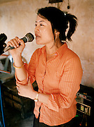 "Singer at Lao ""naming"" ceremony for newborn child."