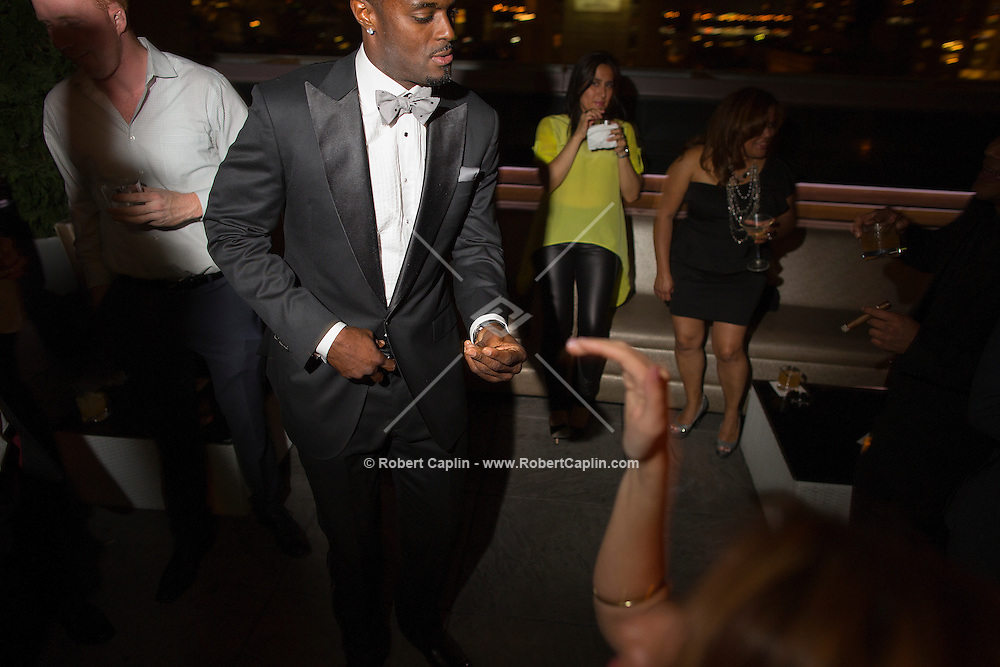 NFL star Plaxico Burress celebrates the launch of his new men's luxury sock line, The Plaxico Burress Collection at XVI Rooftop in New York.  The event was sponsored by Ferrari of Long Island, Maserati of Manhattan, Champagne Billionaires Row, and Dusse Cognac, and  served to highlight The Plaxico Burress Foundation, a charity that provides support for At Risk High School Students...(Photo by Robert Caplin).