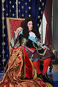 Scene of a man playing King Louis XIV of France, 1638-1715, seated on a throne. Image taken from the filming of 'Paris la ville a remonter le temps' written by Carlo de Boutiny and Alain Zenou, directed by Xavier Lefebvre, a Gedeon Programmes production. Picture by Manuel Cohen
