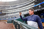 Tampa Bay Rays pitching coach Jim Hickey takes pictures of the snow falling as a rain delay turns into a baseball game called because of snow, at Kauffman Stadium in Kansas City, Mo., Thursday, May 2, 2013.  The Rays were playing the Royals when the game was stopped in the fourth inning. (AP Photo/Colin E. Braley).