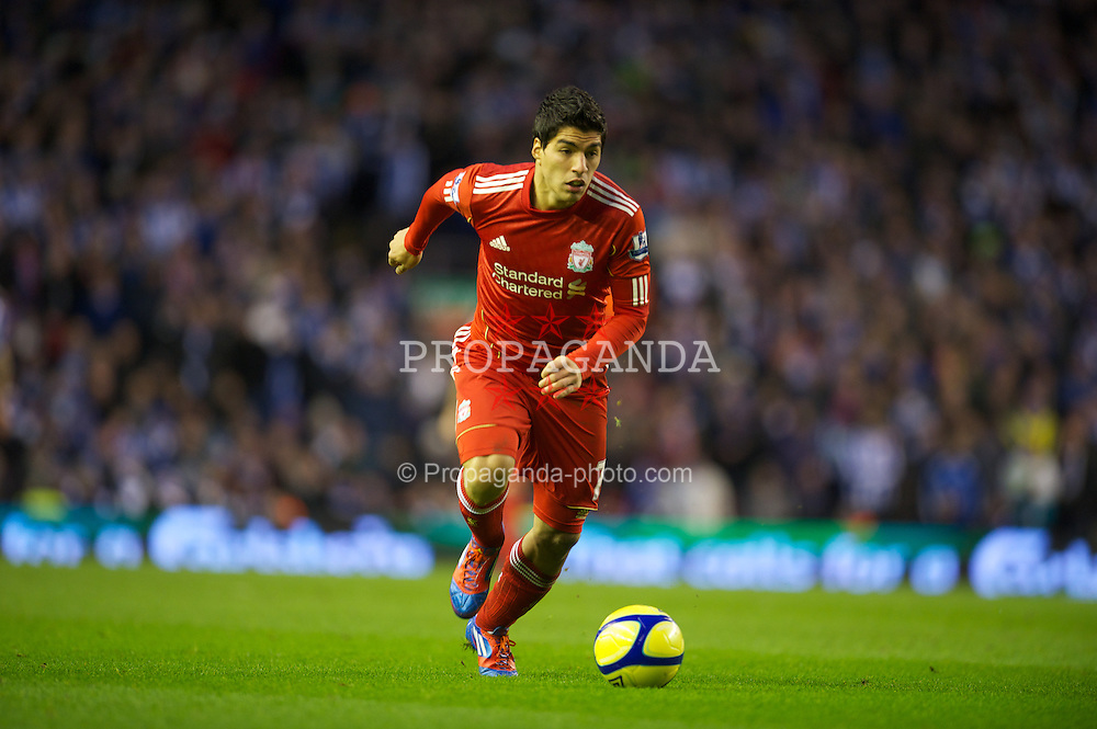 LIVERPOOL, ENGLAND - Saturday, February 19, 2012: Liverpool's Luis Alberto Suarez Diaz in action against Brighton & Hove Albion during the FA Cup 5th Round match at Anfield. (Pic by David Rawcliffe/Propaganda)