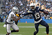 Dec 31, 2017; Carson, CA, USA; Los Angeles Chargers wide receiver Keenan Allen (13) stiff arms Oakland Raiders cornerback T.J. Carrie (38) during an NFL football game at StubHub Center. The Chargers defeated the Raiders 30-10.